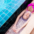 Woman in the swimming pool - Stock Photo