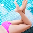 Woman in the swimming pool - Stockfoto