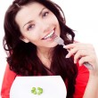 Woman eating peas — Stock Photo #17368161