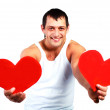 Young man with two hearts — Stock Photo #1795672