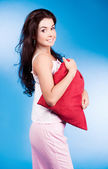 Woman with pillow — Stock Photo
