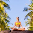 Woman practicing yoga — Foto Stock