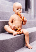 Baby with bread — Stock Photo