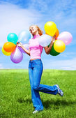 Woman with balloons — Stock Photo
