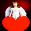 Cute girl with a heart — Stock Photo #1998847