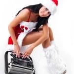 Girl dressed as Santa printing on the typewriter — Stock Photo #3864775