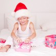 Child opening presents — Stockfoto #7553344