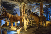 Medieval miners and horses at work in the Wieliczka Salt Mine, Poland. — Stock Photo