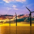 Wind power under sunset — Stock Photo