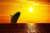 Ship on sunrise sea — ストック写真