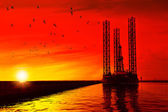 Oil rig at sunset — Stock Photo