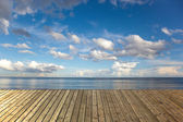 Wooden pier with sea — Stock Photo