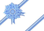 On a ribbon a snowflake — Stock Photo