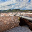 Cannon and panorama of Ibiza, Spain - Stock Photo