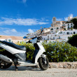 Scooter and panorama of Ibiza, Spain - Stock Photo
