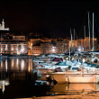 Stock Photo: Marseille, France panorama at night, the harbour and cathedral.