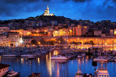 Marseille, France panorama at night, the harbour and cathedral. — Stock Photo