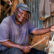 Stock Photo: KENYA, AFRICA - DECEMBER 10: A man carving figures in wood.