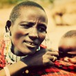 Maasai baby carried by his mother in Tanzania, Africa — Stock Photo #18596309