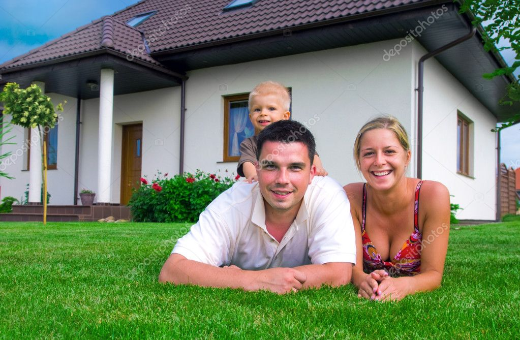 Happy family in front of the house — Stock Photo ... Happy Asian Family In Front Of House