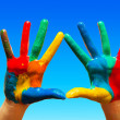 Royalty-Free Stock Photo: Painted hands, colorful fun. blue sky