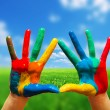 Royalty-Free Stock Photo: Painted colorful hands showing way to clear happy life