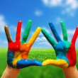 Painted colorful hands showing way to clear happy life — Stock Photo