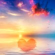 Heart shape in calm ocean at sunset. Beautiful sky — Stock Photo #23361548