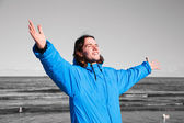 Happy man on the beach - b&w background. Overcoming depression — Stock Photo