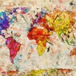 Photo: Vintage world map. Colorful paint, watercolor on grunge, old pap