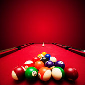 Billards pool game. Color balls in triangle, aiming at cue ball — Stock Photo