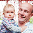 Father with his little baby son portrait in home — Stock Photo