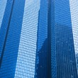 Business skyscrapers modern architecture in blue tint. — Stock Photo