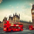 Stock Photo: London, UK. Red bus in motion and Big Ben