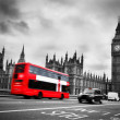 London, the UK. Red bus in motion and Big Ben — Stock Photo