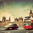 Stock Photo: London, UK. Red bus, taxi cab in motion and Big Ben