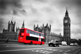 London, the UK. Red bus in motion and Big Ben — Стоковое фото