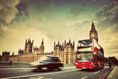 London, the UK. Red bus, taxi cab in motion and Big Ben — Stockfoto