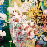 Part of Berlin Wall with graffiti — Stock Photo #29840313