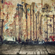 Grunge, rusty concrete wall with random graffiti — Stock Photo