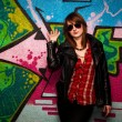 Fashionable girl and colorful graffiti wall — Stock Photo #31805823