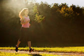 Young fit woman does running, jogging training — Stock Photo
