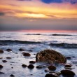 Dramatic sunrise on a rocky beach. Baltic sea — Stock Photo