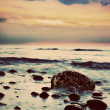 Dramatic sunrise on a rocky beach. Retro, vintage — Stock Photo