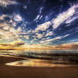 Calm ocean under dramatic sunset sky — Stock Photo