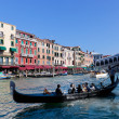Venice, Italy. Gondola with tourists floats on Grand Canal — Stock Photo
