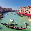 Venice, Italy. Gondola with tourists floats on Grand Canal — Stock Photo #34247045