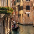 Venice, Italy. Gondola floats on a canal among old Venetian architecture — Stok fotoğraf