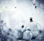 Christmas glass balls on winter vintage background — Stock Photo