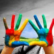 Painted colorful hands showing way to colorful happy life — Stock Photo